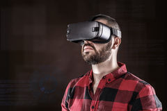 Man wearing virtual reality glasses Stock Image