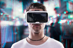 Man wearing virtual reality goggles against night city Royalty Free Stock Image
