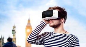 Man wearing virtual reality goggles. Big Ben, London, England. Royalty Free Stock Image