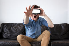 Man wearing virtual reality goggles Royalty Free Stock Photo