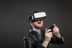 Man wearing virtual reality goggles stock image