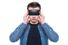 Man wearing virtual reality goggles isolated on white background Stock Images