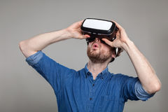 Man wearing virtual reality goggles Stock Images