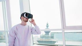 Man wearing virtual reality goggles. Stock Image