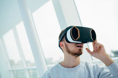 Man wearing virtual reality goggles. Royalty Free Stock Photo