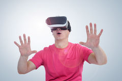 Man wearing virtual reality goggles. Surprise and delight Royalty Free Stock Photo
