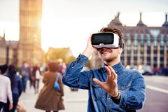Man wearing virtual reality goggles. Westminster Bridge, London, Stock Images
