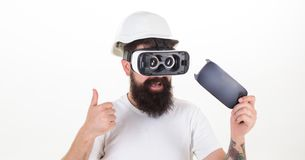 Man wearing virtual reality goggles. Man wearing virtual reality goggles in white background. Virtual reality. Man wearing virtual reality goggles. Man wearing royalty free stock image