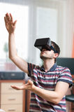 Man is wearing virtual reality headset Royalty Free Stock Photos