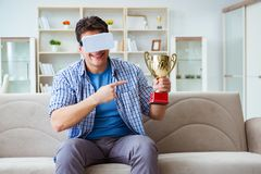 The man wearing virtual reality vr glasses receiving prize cup award Stock Images