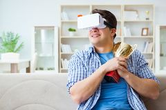 The man wearing virtual reality vr glasses receiving prize cup award Royalty Free Stock Photos