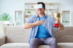 The man wearing virtual reality vr glasses receiving prize cup award Royalty Free Stock Photo