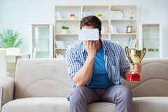 The man wearing virtual reality vr glasses receiving prize cup award. Man wearing virtual reality VR glasses receiving prize cup award Royalty Free Stock Photo