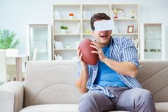Man wearing virtual reality VR glasses watching american footbal Royalty Free Stock Photography