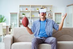 Man wearing virtual reality VR glasses watching american footbal Royalty Free Stock Images