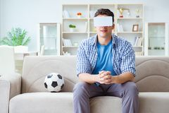 The man wearing virtual reality vr glasses watching soccer football Royalty Free Stock Images