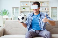 The man wearing virtual reality vr glasses watching soccer football Stock Photo
