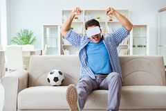 The man wearing virtual reality vr glasses watching soccer football Royalty Free Stock Image