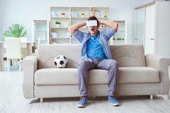 The man wearing virtual reality vr glasses watching soccer football Royalty Free Stock Photos