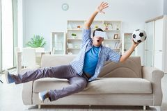 The man wearing virtual reality vr glasses watching soccer football Stock Images
