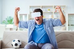 The man wearing virtual reality vr glasses watching soccer football Royalty Free Stock Photo