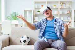 The man wearing virtual reality vr glasses watching soccer football Stock Photos