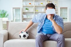 The man wearing virtual reality vr glasses watching soccer football. Man wearing virtual reality VR glasses watching soccer football Stock Image