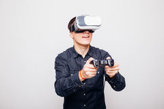 Man wearing virtual reality VR headset for box. Young male playing video games with virtual reality headset and joystick or driving with remote control stock images