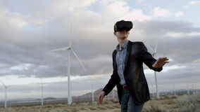 A man wearing virtual realty headset. A man in virtual realty headset standing in the countryside stock video footage