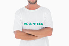 Man wearing volunteer tshirt with arms crossed Royalty Free Stock Photography