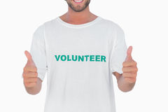 Man wearing volunteer tshirt giving thumbs up Royalty Free Stock Image