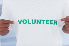 Man wearing volunteer tshirt Royalty Free Stock Images