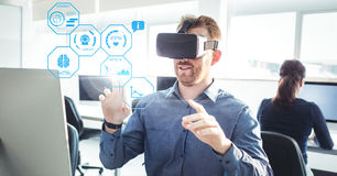 Man wearing VR Fitness Health Virtual Reality Headset with Interface. Digital composite of Man wearing VR Fitness Health Virtual Reality Headset with Interface stock images