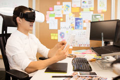 Man wearing vr glasses in creative office. Man wearing vr glasses while using digital tablet in creative office Royalty Free Stock Images