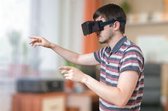Man is wearing vr glasses and touching something Royalty Free Stock Image