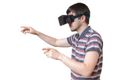 Man is wearing vr glasses and touching something. Isolated on white. Royalty Free Stock Photography
