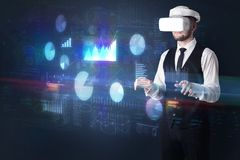 Man wearing VR goggles with charts and reports Stock Images