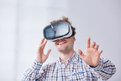 Man wearing vr goggles. Happy man wearing vr goggles, white background Stock Images