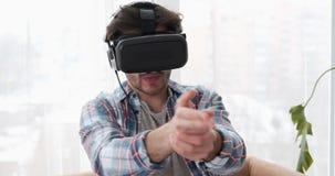 Man wearing vr headset playing shooter game stock video