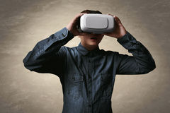 Man wearing vr. Man wearing virtual reality headset Stock Photo