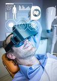 Man wearing VR Virtual Reality Headset with Health Fitness Medical Interface. Digital composite of Man wearing VR Virtual Reality Headset with Health Fitness royalty free stock photo