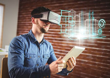 Man wearing VR Virtual Reality Headset with Interface. Digital composite of Man wearing VR Virtual Reality Headset with Interface Stock Photo