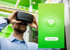 Man wearing VR Virtual Reality Headset with Pay Now Interface Royalty Free Stock Photo