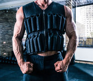 Man wearing in weighting cloth in gym Royalty Free Stock Photo