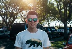 Man Wearing White and Black Bear Printed Shirt and Sunglasses Royalty Free Stock Photo