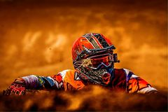Man Wearing White Black and Orange Motorcross Suit Stock Photo