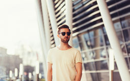 Man wearing white blank t-shirt. With space for your logo Stock Photos