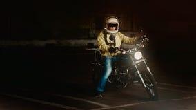 Man Wearing White Full Face Helmet Riding on Standard Motorcycle Stock Photo