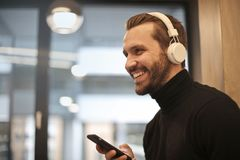 Man Wearing White Headphones Listening to Music royalty free stock photography