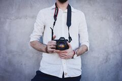 Man Wearing White Long Sleeves Holding Black Canon Dslr Camera Stock Image